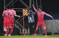 South Korea's Hwang Ui-jo, right, celebrates his goal against Turkmenistan during their Asian zone Group H qualifying soccer match for the FIFA World Cup Qatar 2022 at Goyang stadium in Goyang, South Korea, Saturday, June 5, 2021. (AP Photo/Lee Jin-man)