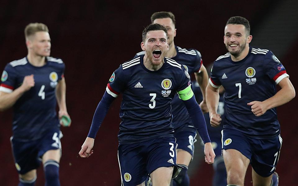 Andy Robertson of Scotland celebrates after his team's victory in the penalty shoot out during the UEFA EURO 2020 Play-Off semi-finals match between Scotland and Israel at Hampden Park - Getty Images Europe