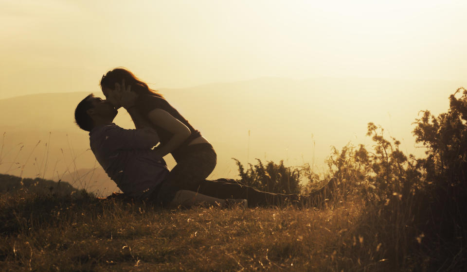 Young couple making love in nature