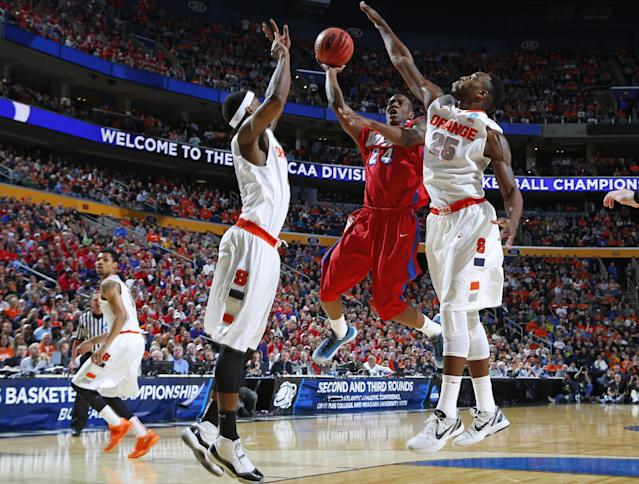Dayton's Jordan Sibert (24) drives past Syracuse's Rakeem Christmas (25) during the first half of a third-round game in the NCAA men's college basketball tournament in Buffalo, N.Y., Saturday, March 22, 2014. (AP Photo/Bill Wippert)