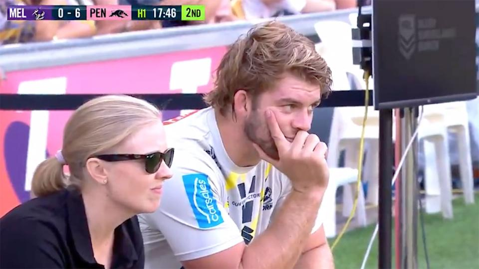 Pictured here, Christian Welch sits on the sideline after failing his HIA.
