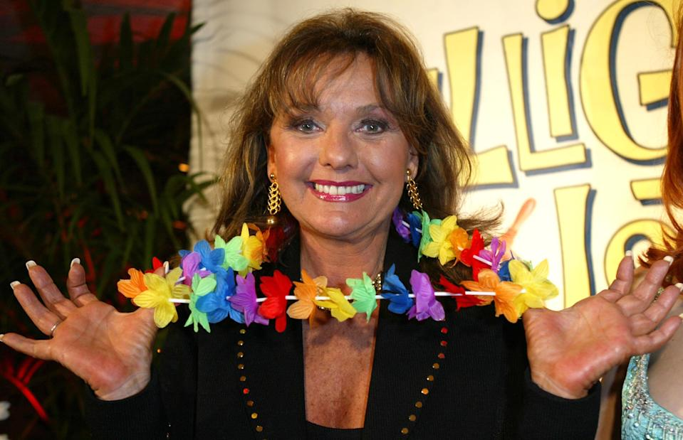 """Dawn Wells, seen in 2004 at a """"Gilligan's Island"""" boat party in Marina del Rey, Calif., played Mary Ann on the silly but beloved '60s sitcom. She died on Dec. 30, 2020, at 82."""