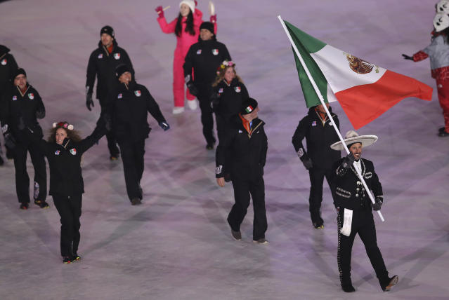 <p>German Madrazo carries the flag of Mexico during the opening ceremony of the 2018 Winter Olympics in Pyeongchang, South Korea, Friday, Feb. 9, 2018. (AP Photo/Michael Sohn) </p>
