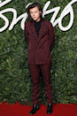 <p>And finally, a perfect note to end on — the red pinstriped Lanvin number Harry wore to the British Fashion Awards in 2014. Oh, the suit places he would go! </p>