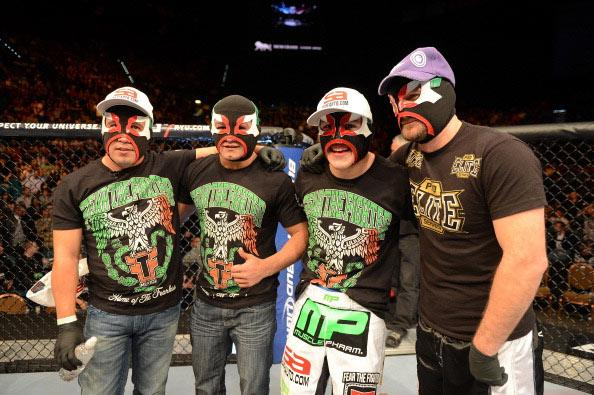 LAS VEGAS, NV - DECEMBER 29: Erik Perez (second from right) and teammates wearing lucha libre masks at UFC 155 on December 29, 2012 at MGM Grand Garden Arena in Las Vegas, Nevada. (Photo by Donald Miralle/Zuffa LLC/Zuffa LLC via Getty Images)