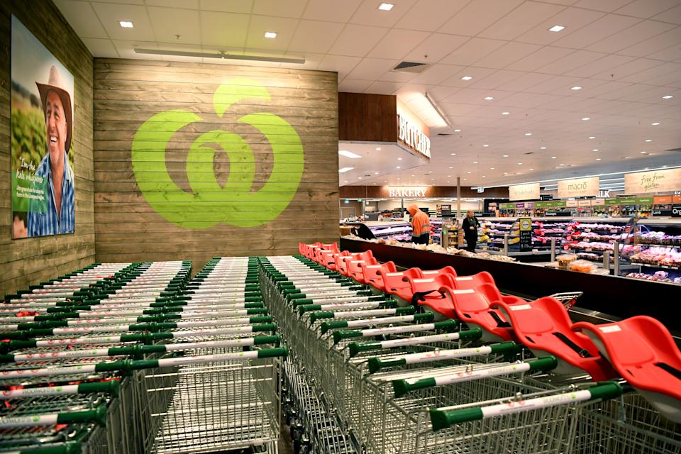 Pictured is a Woolworths store, with lines of trolleys at the front for customers to use.