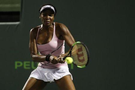Mar 27, 2017; Miami, FL, USA; Venus Williams of the United States hits a backhand against Svetlana Kuznetsova of Russia (not pictured) on day seven of the 2017 Miami Open at Crandon Park Tennis Center. Williams won 6-3, 7-6(4). Mandatory Credit: Geoff Burke-USA TODAY Sports