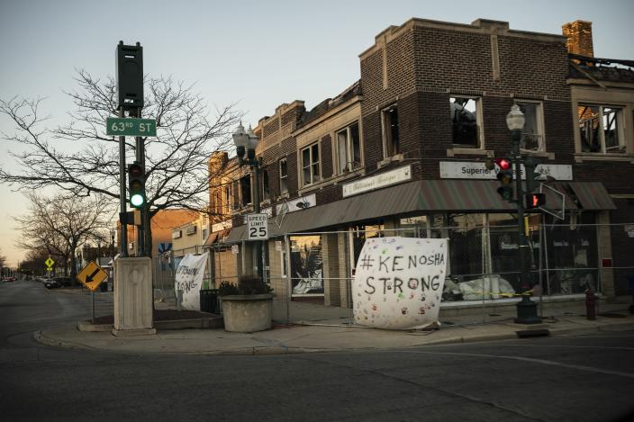 """A banner which reads """"Kenosha Strong"""" hangs on the facade of a building that was damaged during protests in Kenosha, Wis., Sunday, Nov. 1, 2020. The trouble in Kenosha began on Aug. 23 when a Kenosha police officer, responding to a call about a domestic dispute, was caught on video shooting Jacob Blake repeatedly in the back at close range. Blake, a Black man, survived but is partially paralyzed. The August shootings have spurred a spike in political involvement in Kenosha, with the formation of activism and waves of new voters signing up. (AP Photo/Wong Maye-E)"""
