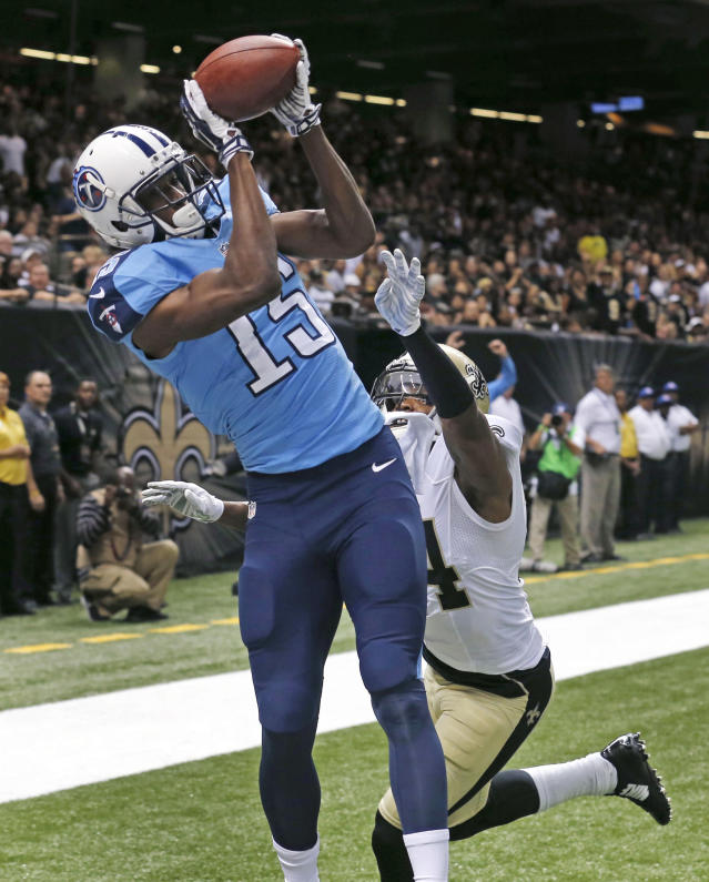 Tennessee Titans wide receiver Justin Hunter (15) pulls in a touchdown reception over New Orleans Saints cornerback Corey White (24) in the first half of a NFL preseason football game in New Orleans, Friday, Aug. 15, 2014. (AP Photo/Bill Haber)