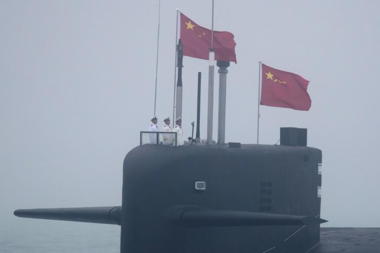 China's military spending has risen in tandem with its growing economy and has seen an increase for 26 consecutive years, reaching an estimated $252 billion in 2020 (pictured: a 094A Jin-class nuclear submarine Long March 10)