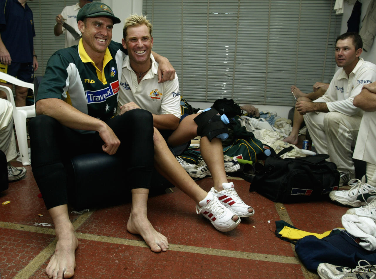SHARJAH - OCTOBER 12:  Matthew Hayden of Australia reflects on his century with team mate Shane Warne who took eight wickets in the match after day two of the Second Test match between Pakistan and Australia played at Sharjah International Cricket Stadium in Sharjah, United Arab Emirates on October 12, 2002. (Photo by Hamish Blair/Getty Images)