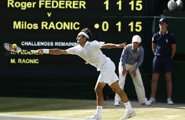 Roger Federer of Switzerland plays a return to Milos Raonic of Canada during their men's singles semifinal match at the All England Lawn Tennis Championships in Wimbledon, London, Friday, July 4, 2014. (AP Photo/Ben Curtis)
