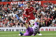 Newcastle's goalkeeper Freddie Woodman fails to stop Manchester United's Cristiano Ronaldo scoring the opening goal during the English Premier League soccer match between Manchester United and Newcastle United at Old Trafford stadium in Manchester, England, Saturday, Sept. 11, 2021. (AP Photo/Rui Vieira)