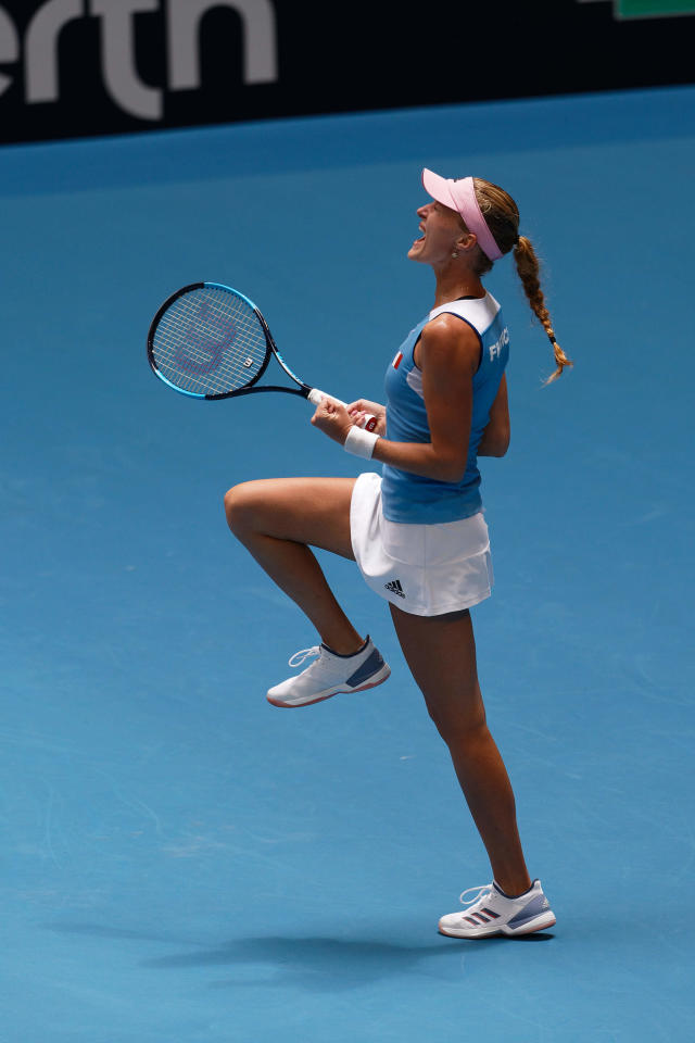 France's Kristina Mladenovic celebrates winning her match against Australia's Ajla Tomljanovic during their Fed Cup tennis final in Perth, Australia, Saturday, Nov. 9, 2019. (AP Photo/Trevor Collens)