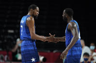 United States' Kevin Durant (7), left, celebrates with teammate Draymond Green (14) after their win in the men's basketball quarterfinal game against Spain at the 2020 Summer Olympics, Tuesday, Aug. 3, 2021, in Saitama, Japan. (AP Photo/Charlie Neibergall)