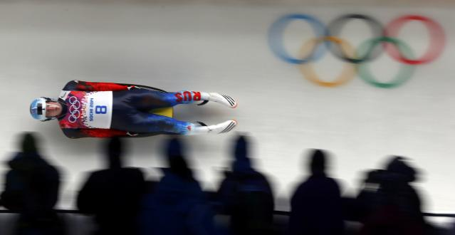 Russia's Semen Pavlichenko speeds down the track during the men's singles luge competition at the 2014 Sochi Winter Olympics, February 8, 2014. REUTERS/Arnd Wiegmann (RUSSIA - Tags: SPORT LUGE)
