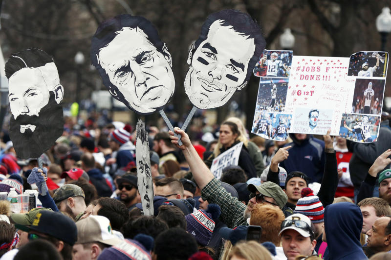 Fans gather on to watch the New England Patriots parade through downtown Boston, Tuesday, Feb. 5, 2019, to celebrate their win over the Los Angeles Rams in Sunday's NFL Super Bowl 53 football game in Atlanta. (AP Photo/Michael Dwyer)