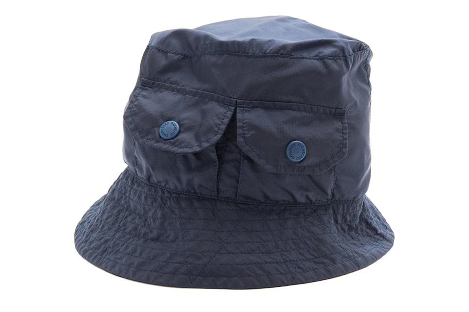 """<p>Beanies and dad caps? Par for the course. But a wonky bucket hat with cargo pockets is the right swerve to make.</p> <p><em>Engineered Garments Explorer hat</em></p> $132, Nepenthes. <a href=""""https://nepenthesny.com/collections/accessories/products/explorer-hat-navy-nylon-micro-ripstop?variant=39299352494256"""" rel=""""nofollow noopener"""" target=""""_blank"""" data-ylk=""""slk:Get it now!"""" class=""""link rapid-noclick-resp"""">Get it now!</a>"""