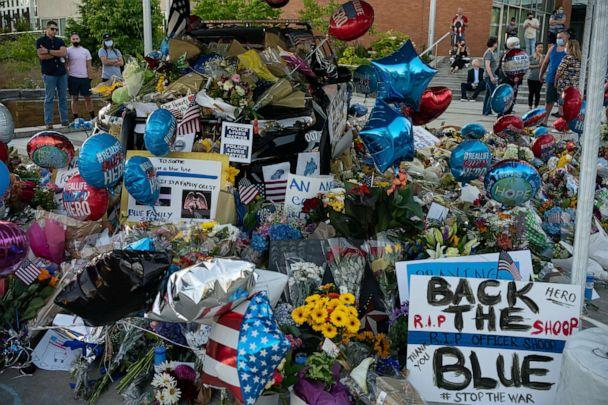 PHOTO: A memorial for slain Police Officer Jonathan Shoop is shown outside the Bothell Police Department on July 14, 2020 in Bothell, Washington. (David Ryder/Getty Images)