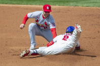 Philadelphia Phillies' Jean Segura, right, is safe at second on a double before St. Louis Cardinals shortstop Paul DeJong, left, can make the tag during the second inning of a baseball game, Sunday, April 18, 2021, in Philadelphia. (AP Photo/Laurence Kesterson)