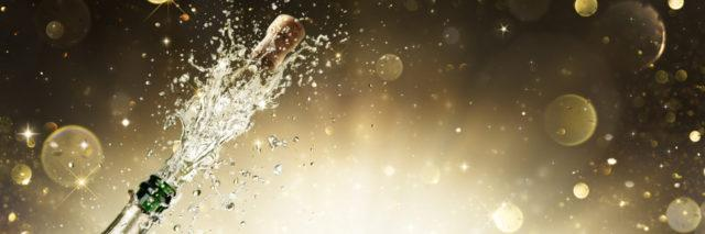 Champagne bottle with golden background.