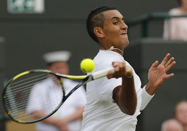 Nick Kyrgios of Australia returns during the men's singles quarterfinal match against Milos Raonic of Canada at the All England Lawn Tennis Championships in Wimbledon, London, Wednesday, July 2, 2014. (AP Photo/Ben Curtis)