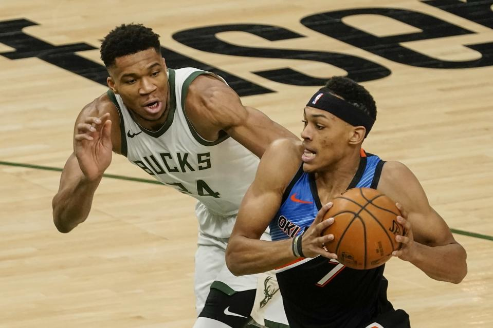 Oklahoma City Thunder's Darius Bazley tries to get past Milwaukee Bucks' Giannis Antetokounmpo during the first half of an NBA basketball game Friday, Feb. 19, 2021, in Milwaukee. (AP Photo/Morry Gash)