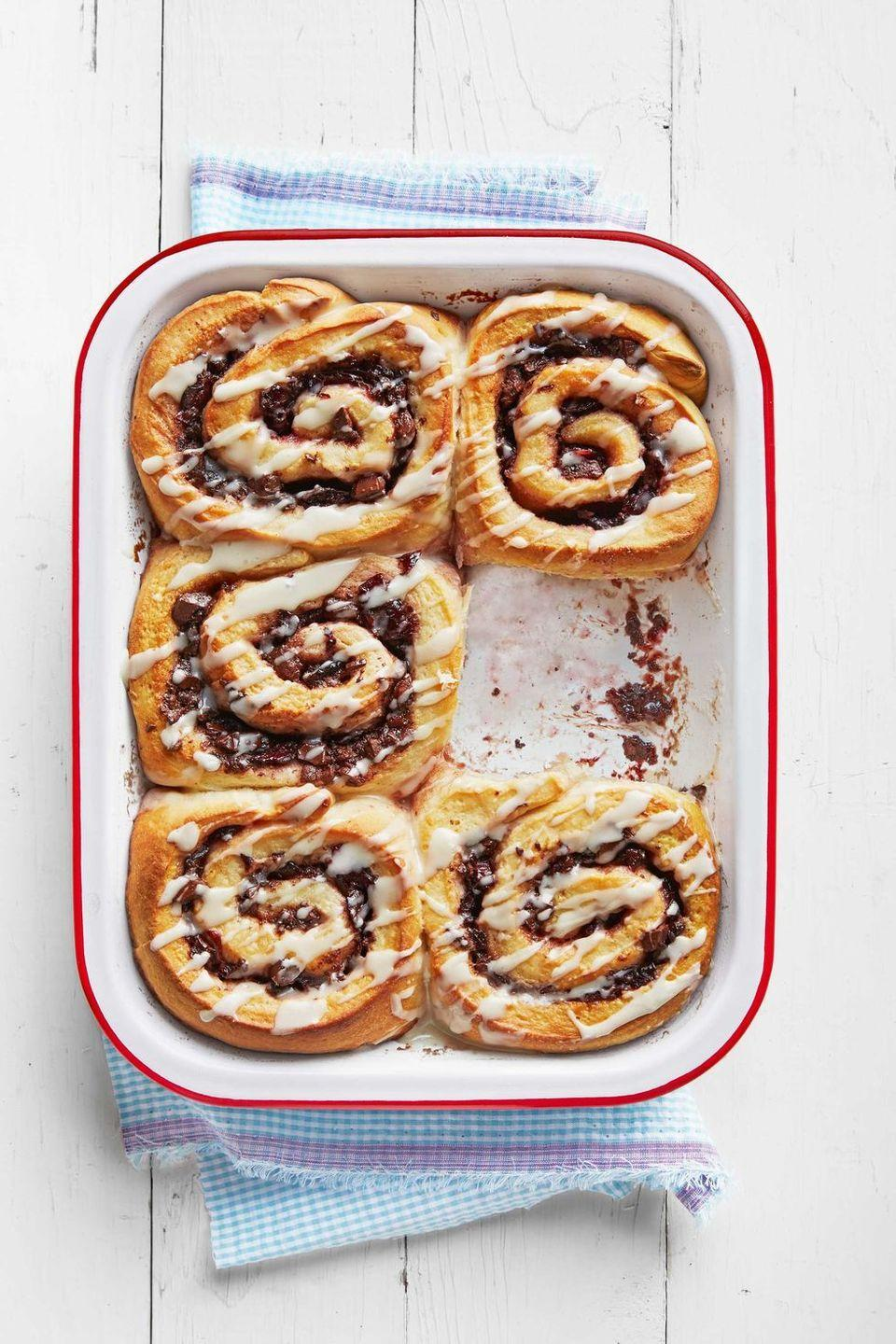 """<p>Savory bittersweet chocolate and sweet cherries take these cinnamon rolls to the next level. Bonus: They can be made the day before.</p><p><strong><a href=""""https://www.countryliving.com/food-drinks/recipes/a38954/chocolate-cherry-cinnamon-rolls-recipe/"""" rel=""""nofollow noopener"""" target=""""_blank"""" data-ylk=""""slk:Get the recipe"""" class=""""link rapid-noclick-resp"""">Get the recipe</a>. </strong> </p>"""