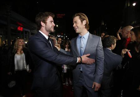 """Cast member Hemsworth greets his brother at the premiere of """"Thor: The Dark World"""" in Hollywood"""