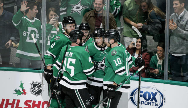 Dallas Stars forward Denis Gurianov, second from right, is congratulated by teammates after scoring a goal during the second period of an NHL hockey game against the Winnipeg Jets on Thursday, Dec. 5, 2019, in Dallas. (AP Photo/Brandon Wade)