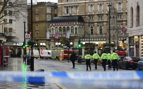 Police officers walk towards Charing Cross station after it was shut due to a gas leak - Credit: David Mirzoeff/PA