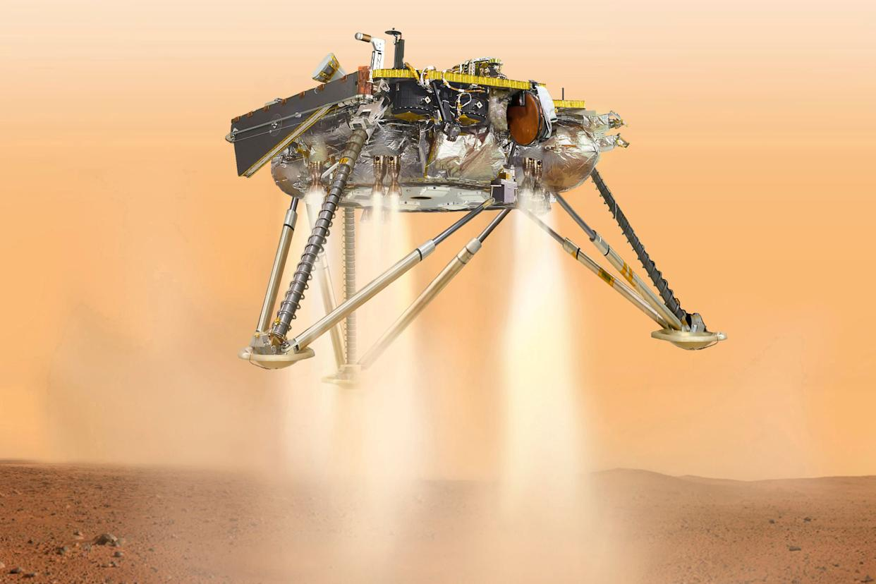 This illustration shows NASA's InSight lander about to touch down on the surface of Mars. (Photo: ASSOCIATED PRESS)