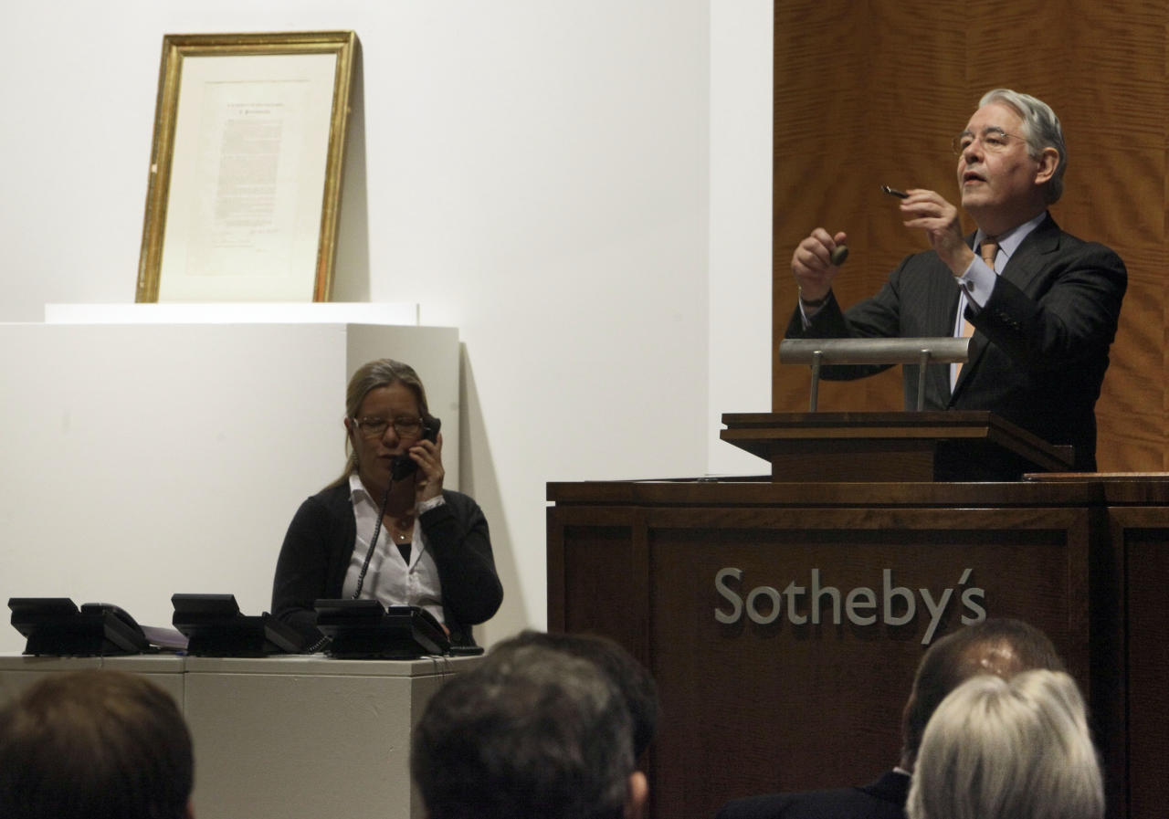 "Auctioneer David Redden conducts bidding for a copy of the Emancipation Proclamation signed by President Abraham Lincoln, that was owned by Robert F. Kennedy, during an auction at Sotheby's, in New York, Friday, Dec. 10, 2010. Kennedy bought the printed copy of the 1863 document declaring all slaves ""forever free"" shortly after its centennial celebration at the White House. It was being sold at Sotheby's by his widow, Ethel.  (AP Photo/Richard Drew)"