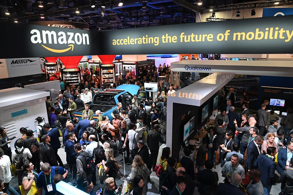 Attendees visit the Amazon booth where a Rivian electric truck with Amazon Alexa integration is displayed, January 7, 2020 at CES 2020 in Las Vegas.