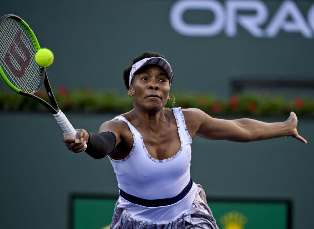 Venus Williams returns a shot to Angelique Kerber, of Germany, at the BNP Paribas Open tennis tournament Thursday, March 14, 2019, in Indian Wells, Calif. (AP Photo/Mark J. Terrill)