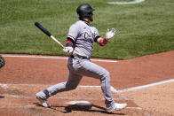Chicago White Sox's Yasmani Grandal follows through on a double off Pittsburgh Pirates starting pitcher Chase De Jong, driving in two runs, during the fifth inning of a baseball game in Pittsburgh, Wednesday, June 23, 2021. (AP Photo/Gene J. Puskar)
