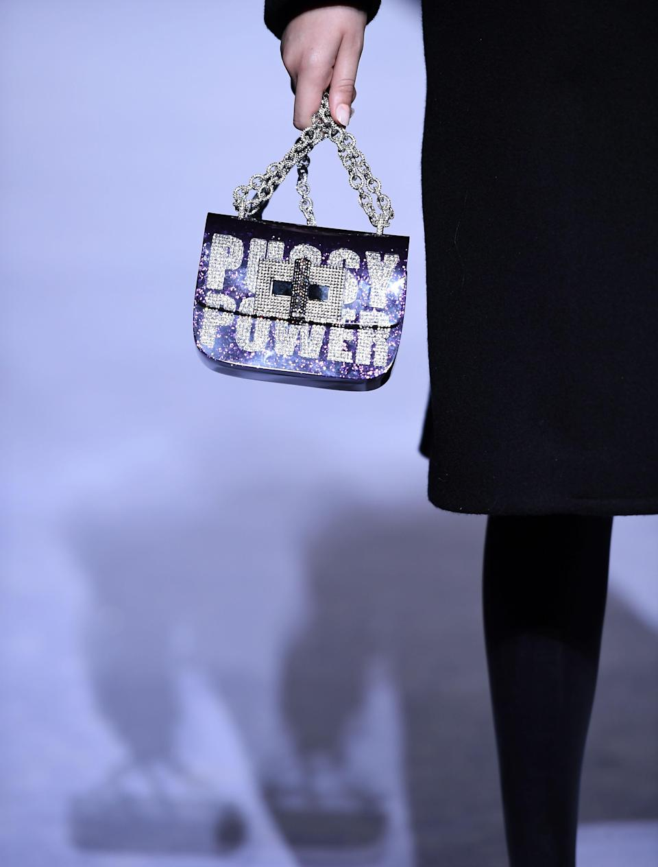 """<p>A close-up of the """"Pussy Power"""" bag at the Tom Ford fall/winter 2018 runway show. (Photo: Getty Images) </p>"""