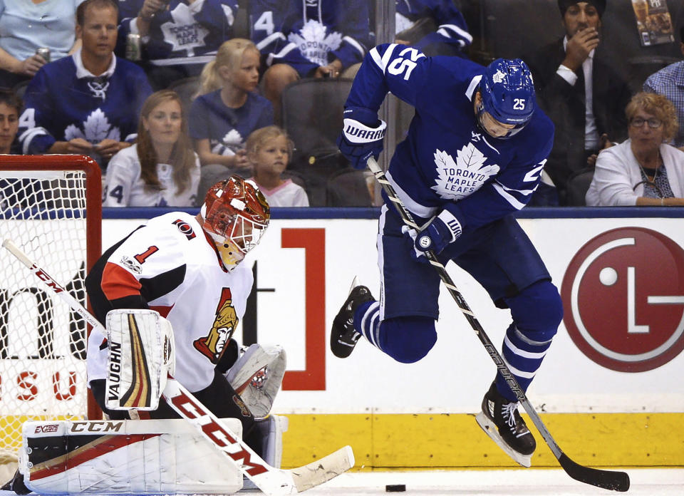 FILE - In this Sept. 19, 2017, file photo, Toronto Maple Leafs left wing James van Riemsdyk (25) leaps as Ottawa Senators goalie Mike Condon (1) makes a save during the first period of a preseason NHL hockey game, in Toronto. A person with direct knowledge of the move says the Philadelphia Flyers have signed left winger James van Riemsdyk to a $35 million, five-year deal. The person spoke to The Associated Press on condition of anonymity because the deal had not been announced.(Frank Gunn/The Canadian Press via AP, File)