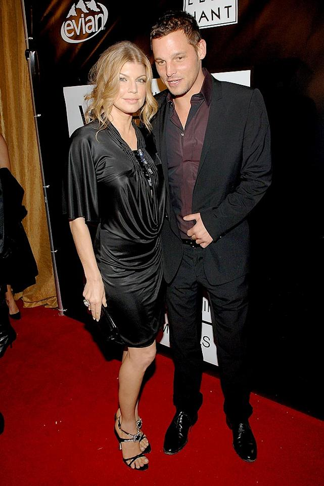 """Fergie's main squeeze Josh Duhamel is nowhere to be found. Instead, she cozies up with """"Grey's Anatomy"""" hottie Justin Chambers on the red carpet. Jamie McCarthy/<a href=""""http://www.wireimage.com"""" target=""""new"""">WireImage.com</a> - November 29, 2007"""