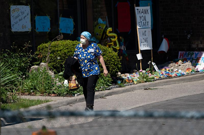 A home-care worker is shown outside Orchard Villa long-term care home in Pickering, Ont., on May 26, 2020. (Photo: CP/Frank Gunn)