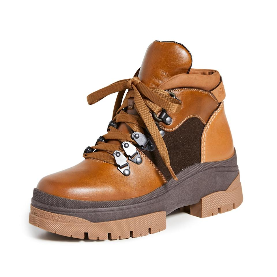 """These are the kinds of chic hiking boots we could totally see a celeb sporting. The color block leather works with just about any outfit—from <a href=""""https://www.glamour.com/gallery/best-yoga-pants?mbid=synd_yahoo_rss"""" rel=""""nofollow noopener"""" target=""""_blank"""" data-ylk=""""slk:yoga pants"""" class=""""link rapid-noclick-resp"""">yoga pants</a> to <a href=""""https://www.glamour.com/gallery/best-spring-dress-styles?mbid=synd_yahoo_rss"""" rel=""""nofollow noopener"""" target=""""_blank"""" data-ylk=""""slk:floral maxis"""" class=""""link rapid-noclick-resp"""">floral maxis</a>—and the platform sole is perfect for wading through puddles and giving yourself a few extra inches (hi, petites). $445, Shopbop. <a href=""""https://www.shopbop.com/aure-flat-hiker-boot-see/vp/v=1/1575615177.htm"""" rel=""""nofollow noopener"""" target=""""_blank"""" data-ylk=""""slk:Get it now!"""" class=""""link rapid-noclick-resp"""">Get it now!</a>"""