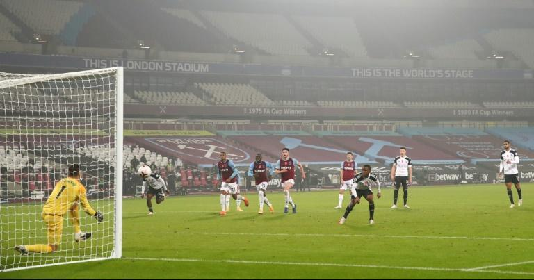 West Ham goalkeeper Lukasz Fabianski saves a last-minute 'Panenka' penalty from Fulham's Ademola Lookman