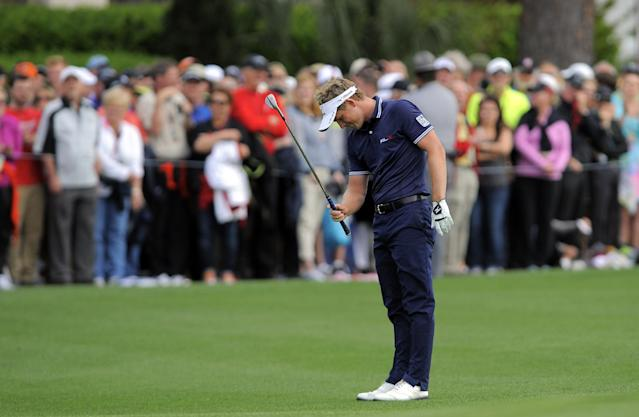 Luke Donald, of England, reacts after missing a putt for birdie on the 18th green during the final round of the RBC Heritage golf tournament in Hilton Head Island, S.C., Sunday, April 20, 2014. Matt Kuchar won the tournament with 11-under par. (AP Photo/Stephen B. Morton)