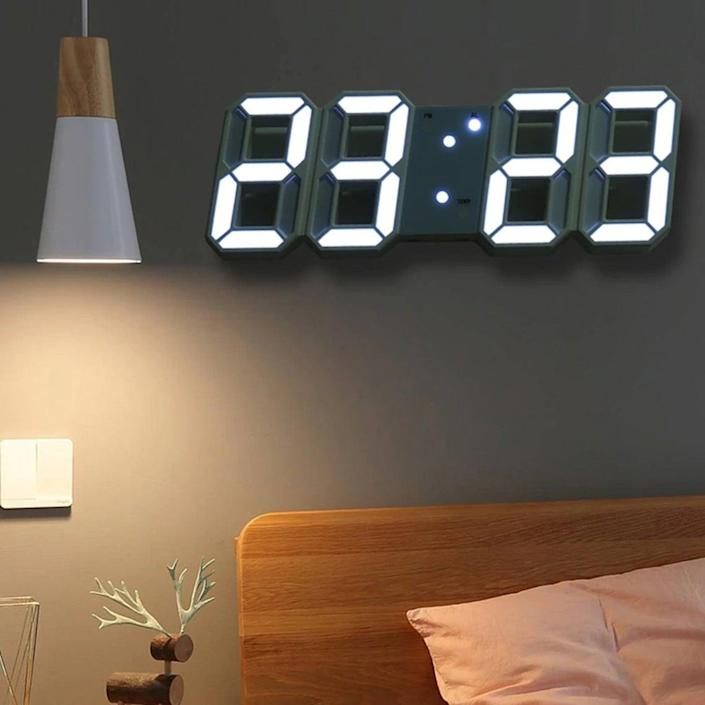 """No need to read the clock hands with this baby! Plus, those LED lights really light up the room. The frame is available in black, white, or green. The brightness is adjustable, and the clock measures nine inches across. $13, Etsy. <a href=""""https://www.etsy.com/listing/955669396/3d-wall-clock-modern-design-stand"""" rel=""""nofollow noopener"""" target=""""_blank"""" data-ylk=""""slk:Get it now!"""" class=""""link rapid-noclick-resp"""">Get it now!</a>"""