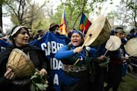 About a thousand activists, many wearing ponchos and headbands, and playing traditional musical instruments, marched in the center of Santiago (AFP/Martin BERNETTI)