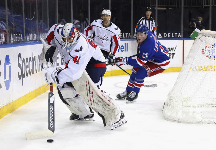 Washington Capitals' Vitek Vanecek looks to clear the puck from behind the net during the second period against the New York Rangers in an NHL hockey game Wednesday, May 5, 2021, in New York. (Bruce Bennett/Pool Photo via AP)