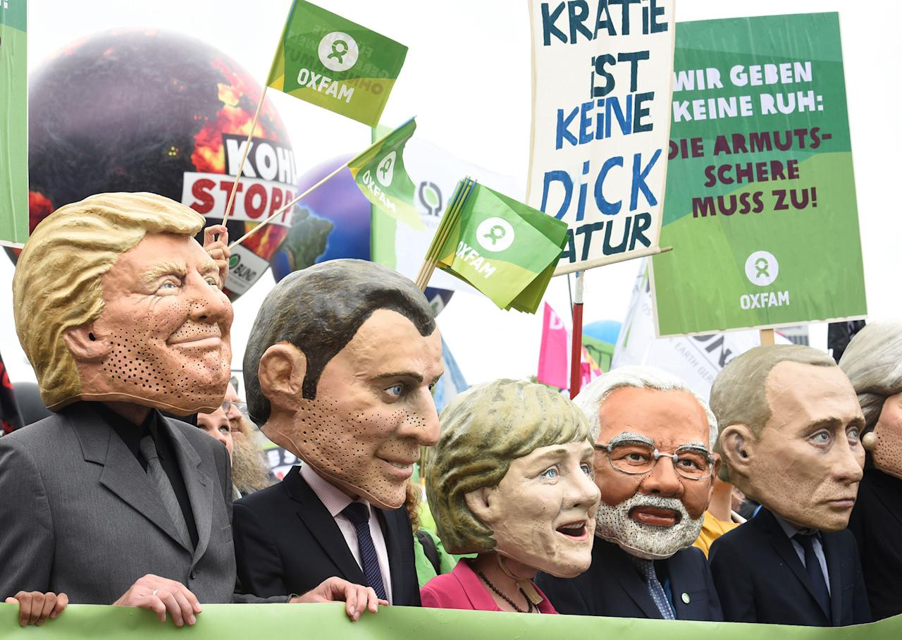 <p>Oxfamís Big Heads depict G20 leaders take part in protests ahead of the upcoming G20 summit in Hamburg, Germany July 2, 2017. (Fabian Bimmer/Reuters) </p>