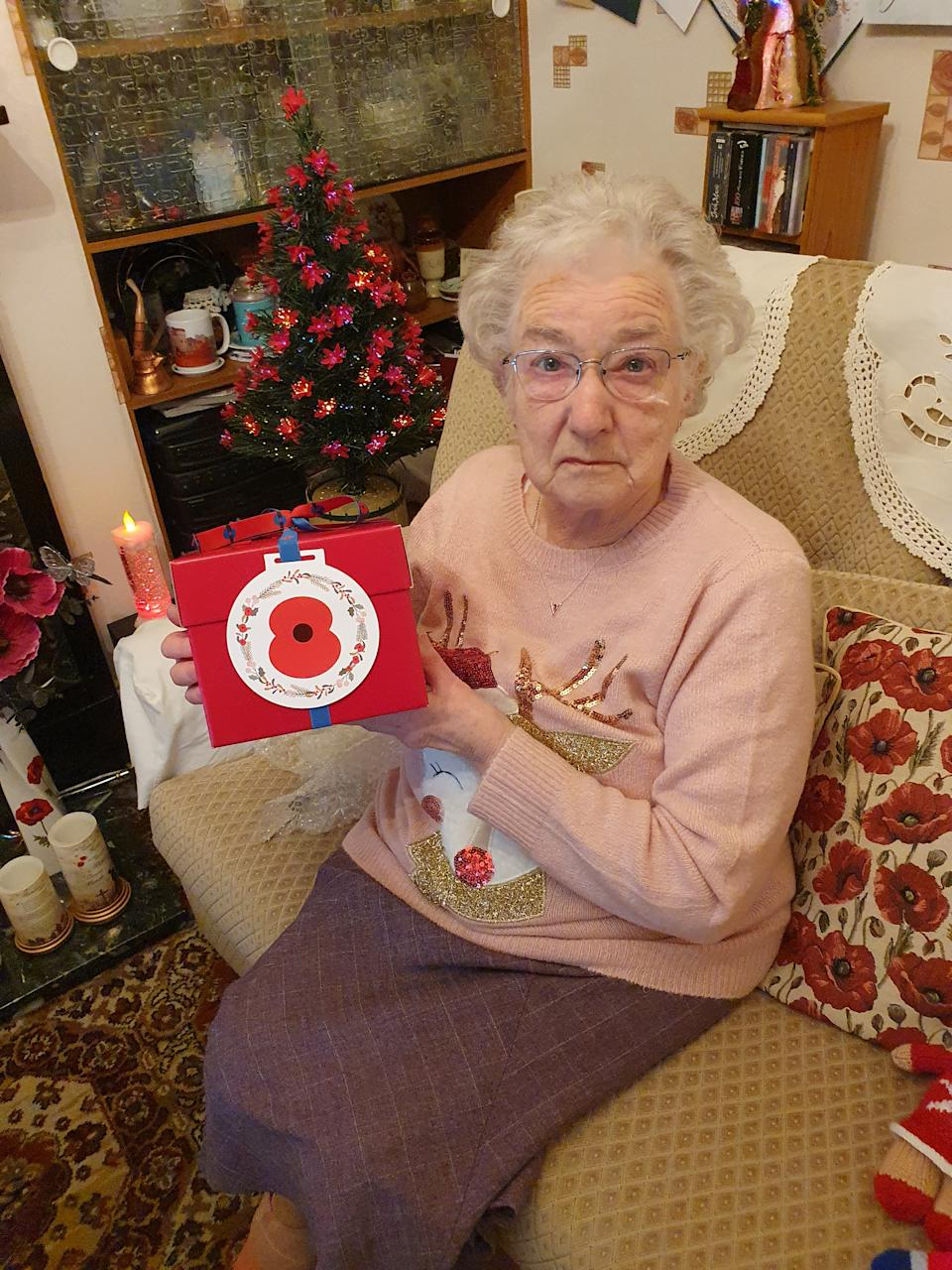 EMBARGOED TO 2200 MONDAY DECEMBER 21 Undated handout photo issued by the Royal British Legion of Vera Parnaby, 81, from Consett, County Durham, who has been a Royal British Legion volunteer for 75 years collecting in excess of £1 million for the Poppy Appeal. Vera was a recipient of a Royal British Legion 'Together at Christmas' gift box containing one of the Christmas puddings made by members of the royal family at Buckingham Palace in 2019. The Royal British Legion has gifted 99 Christmas puddings mixed by four generations of the Royal Family to members of the Armed Forces community across the UK and overseas as part of its 'Together at Christmas' initiative.