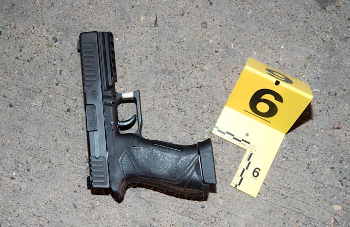 The gun belonging to Philando Castile lies on the ground outside his car.
