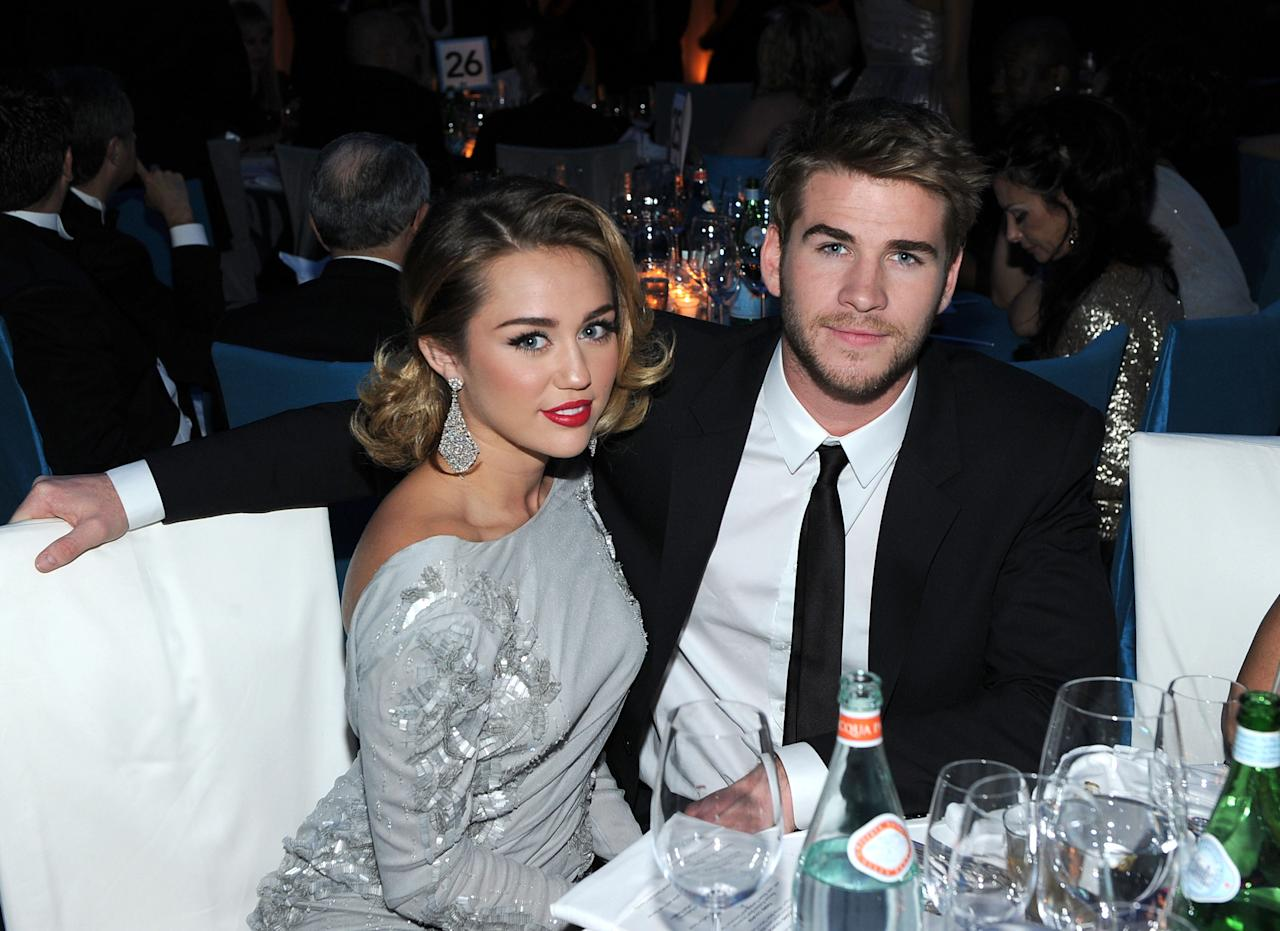 BEVERLY HILLS, CA - FEBRUARY 26:  (L-R) Singer Miley Cyrus and actor Liam Hemsworth attend the 20th Annual Elton John AIDS Foundation Academy Awards Viewing Party at The City of West Hollywood Park on February 26, 2012 in Beverly Hills, California.  (Photo by Larry Busacca/Getty Images for EJAF)